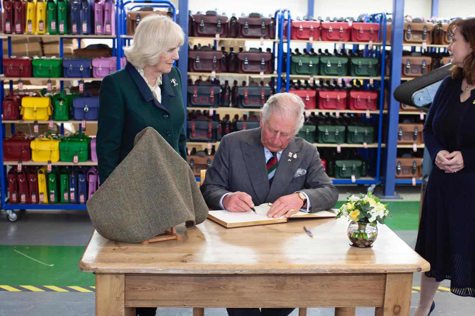 The Duchess of Cornwall and The Prince of Wales visit The Cambridge Satchel Company